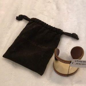 Michael Kors nognac and gold bracelet.